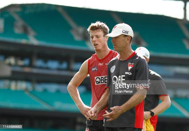 Swans Assistant Coach John Blakey speaks to his son Nick Blakey of the Swans during a Sydney Swans AFL training session at the Sydney Cricket Ground...