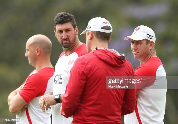 Swans assistant coaches Steve Johnson Tadhg Kennelly and Dean Cox talk to Swans head coach John Longmire during a Sydney Swans AFL preseason training...