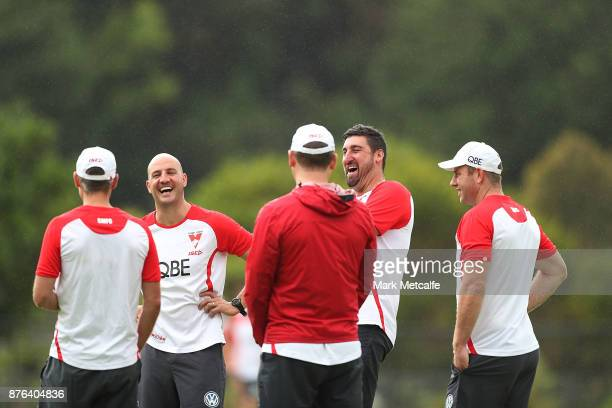 Swans assistant coaches Steve Johnson Tadhg Kennelly Brett Kirk and Dean Cox talk to Swans head coach John Longmire during a Sydney Swans AFL...