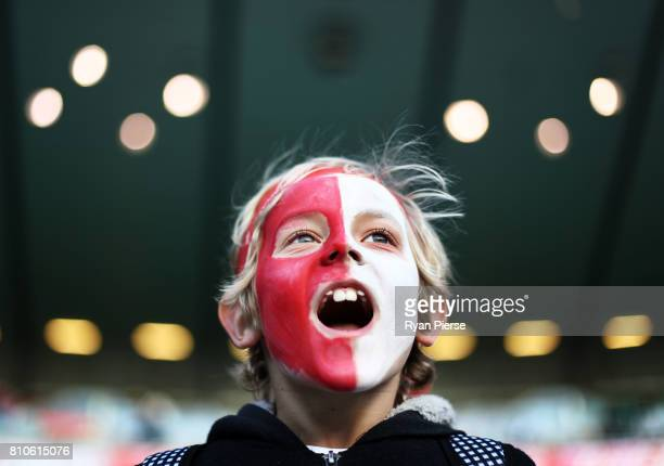 Swans fan cheers during the round 16 AFL match between the Sydney Swans and the Gold Coast Suns at Sydney Cricket Ground on July 8 2017 in Sydney...