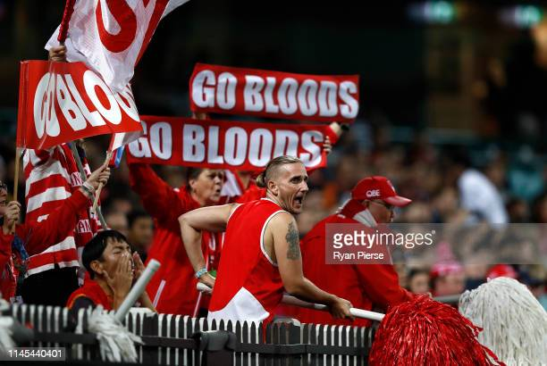 Swans fans cheer during the round 6 AFL match between the Sydney Swans and GWS Giants at Sydney Cricket Ground on April 27, 2019 in Sydney, Australia.