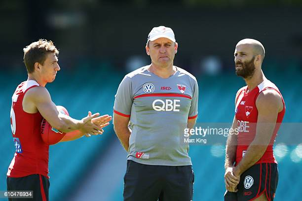 Swans head coach John Longmire speaks to Kieren Jack of the Swans and Jarrad McVeigh of the Swans during a Sydney Swans AFL training session at...