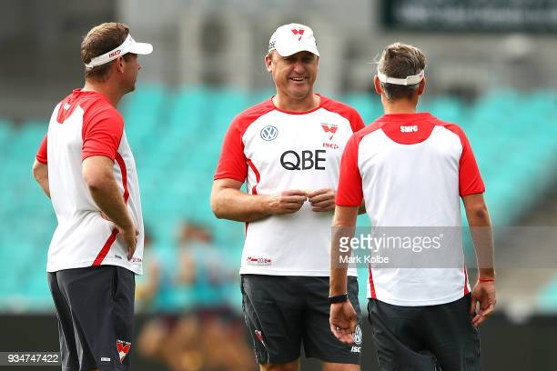 Swans head coach John Longmire speaks to members of the coaching staff during a Sydney Swans AFL training session at Sydney Cricket Ground on March...