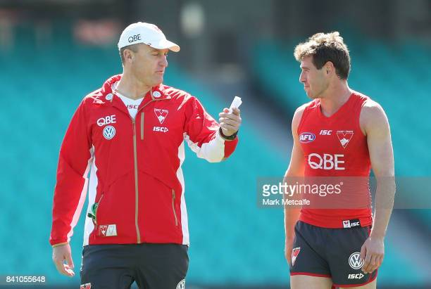 Swans head coach John Longmire talks to Nick Smith of the Swans during a Sydney Swans AFL training session at Sydney Cricket Ground on August 31 2017...