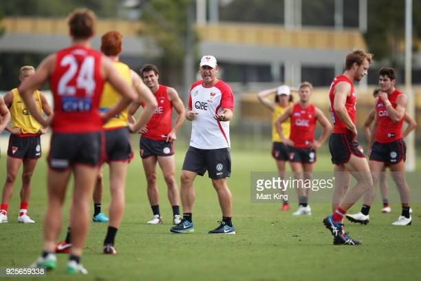 Swans head coach John Longmire talks to players during a Sydney Swans AFL training session at Lakeside Oval on March 1 2018 in Sydney Australia