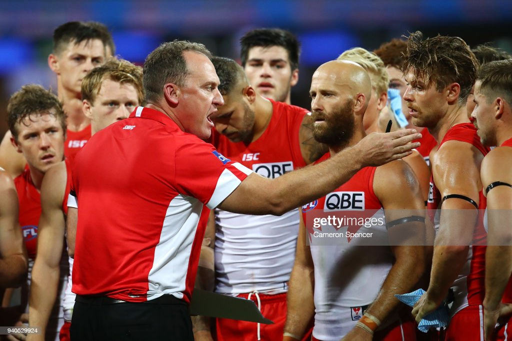 Swans head coach, John Longmire talks to players during the round two AFL match between the Sydney Swans and the Port Adelaide Power at the Sydney Cricket Ground on April 1, 2018 in Sydney, Australia.