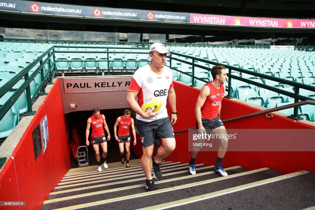 Swans head coach John Longmire walks onto the pitch during a Sydney Swans AFL training session at Sydney Cricket Ground on September 13, 2017 in Sydney, Australia.