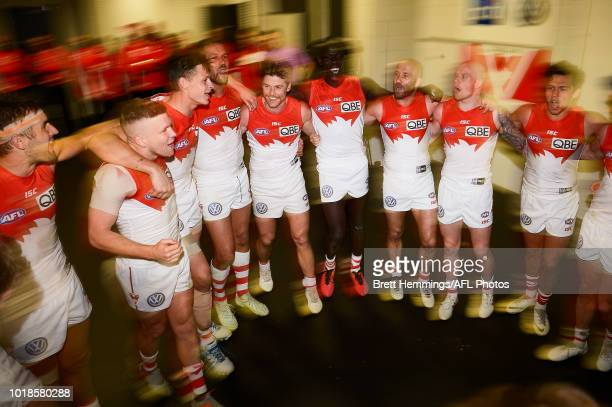 Swans players celebrate victory during the round 22 AFL match between the Greater Western Sydney Giants and the Sydney Swans at Spotless Stadium on...