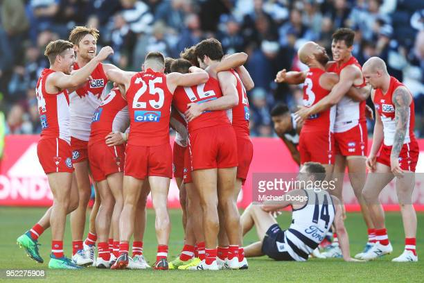 Swans players celebrates the win on the final siren with teammates during the round six AFL match between the Geelong Cats and Sydney Swans at GMHBA...