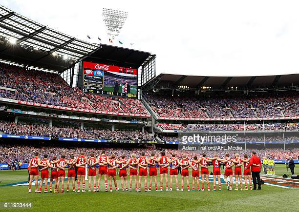 Swans players line up for the national anthem during the 2016 Toyota AFL Grand Final match between the Sydney Swans and the Western Bulldogs at the...