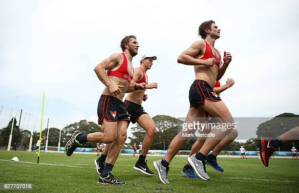Swans players run during a Sydney Swans AFL preseason training session at Lakeside Oval on December 5 2016 in Sydney Australia
