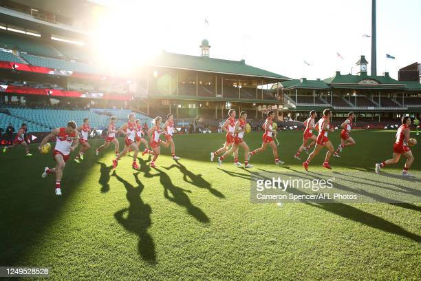 Swans players run onto the field during the round 2 AFL match between the Sydney Swans and the Essendon Bombers at Sydney Cricket Ground on June 14,...
