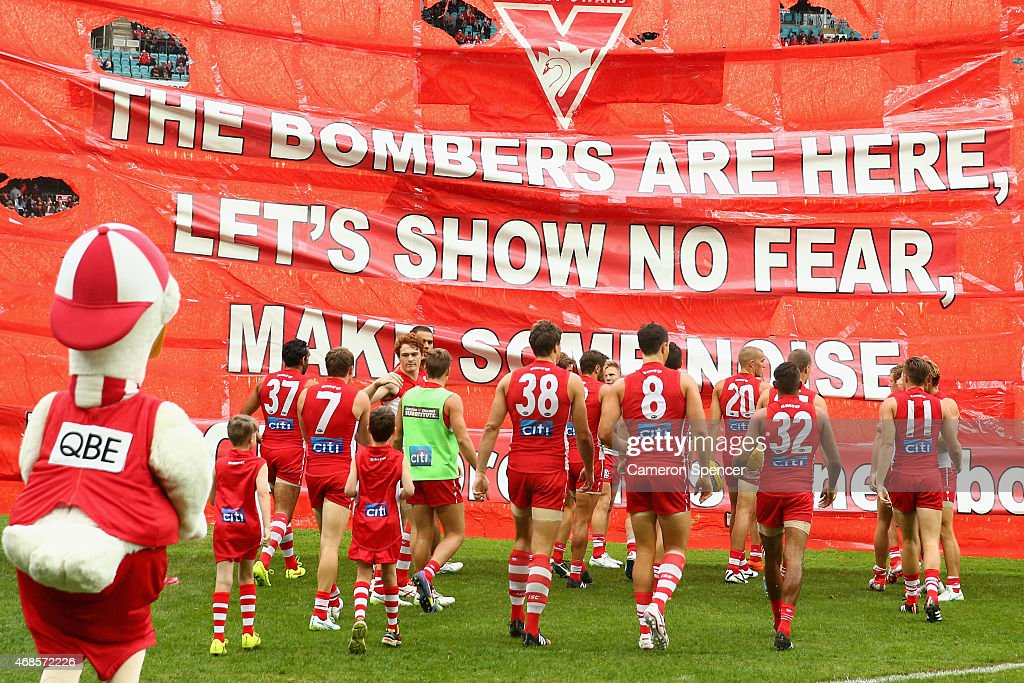 Swans players run through their banner during the Round ...