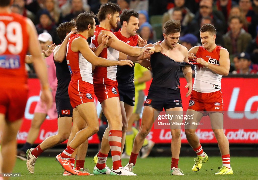Swans players wrestle with Tomas Bugg of the Demons during the 2017 AFL round 15 match between the Melbourne Demons and the Sydney Swans at the Melbourne Cricket Ground on June 30, 2017 in Melbourne, Australia. (Photo by Michael Willson/AFL Media/Getty Images))