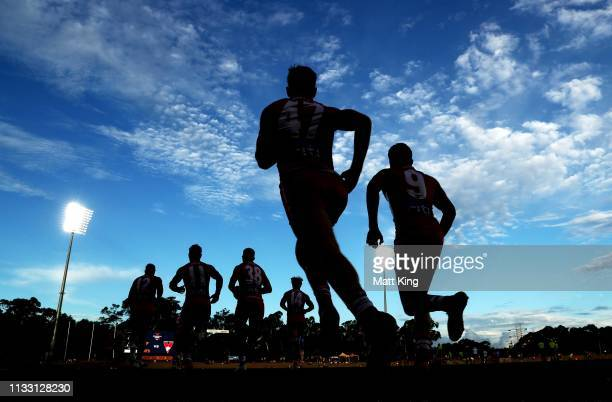 Swans take to the field during the 2019 JLT Community Series AFL match between the Greater Western Sydney Giants and the Sydney Swans at Blacktown...