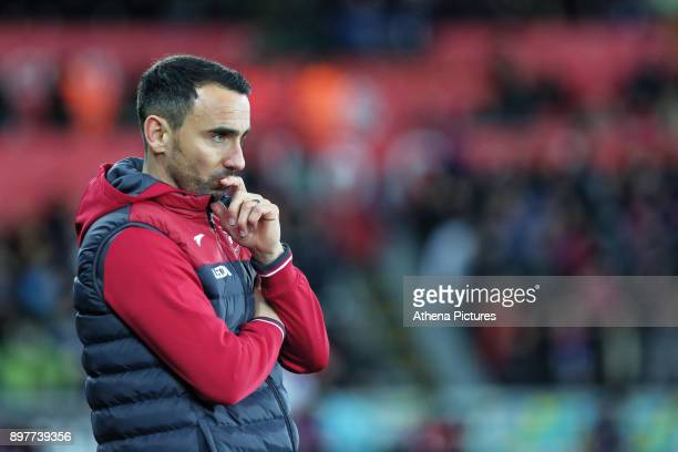 Swansea caretaker manager Leon Britton watches the game from the touchline during the Premier League match between Swansea City and Crystal Palace at...