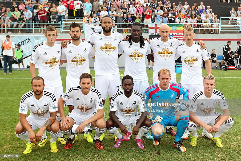 Swansea City AFC, of Wales, takes a team photo before ...