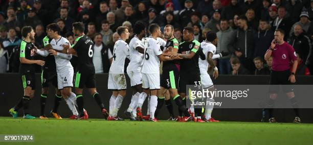 Swansea City and AFC Bournemouth players clash during the Premier League match between Swansea City and AFC Bournemouth at Liberty Stadium on...