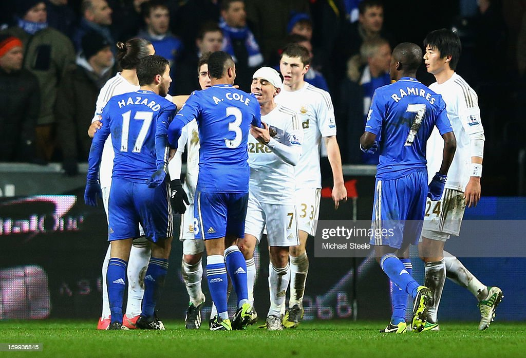 Swansea City and Chelsea players clash as Eden Hazard of Chelsea (17) kicks a ball boy during the Capital One Cup Semi-Final Second Leg match between Swansea City and Chelsea at Liberty Stadium on January 23, 2013 in Swansea, Wales. Hazard is sent off following the incident.