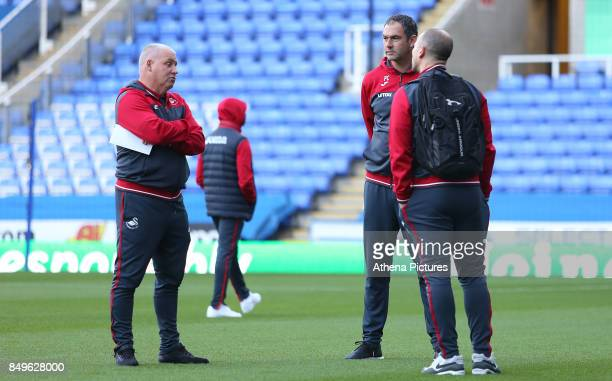 Swansea City assistant coach Nigel Gibbs talks with Swansea City manager Paul Clement prior to kick off during the Carabao Cup Third Round match...