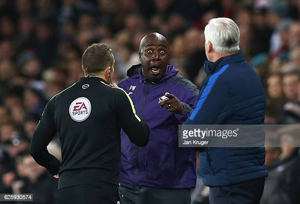 Swansea City assistant manager Paul Williams talks to the fourth official during the Premier League match between Swansea City and Crystal Palace at...