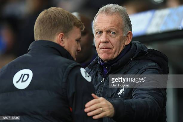 Swansea City caretaker manager Alan Curtis and Eddie Howe Manager of AFC Bournemouth greet prior to the Premier League match between Swansea City and...