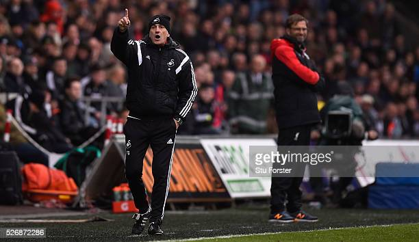 Swansea City coach Francesco Guidolin reacts during the Barclays Premier League match between Swansea City and Liverpool at The Liberty Stadium on...