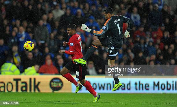 Swansea City goalkeeper Michel Vorm fouls Cardiff player Fraizer Campbell as is sent off during the Barclays Premier League match between Cardiff...