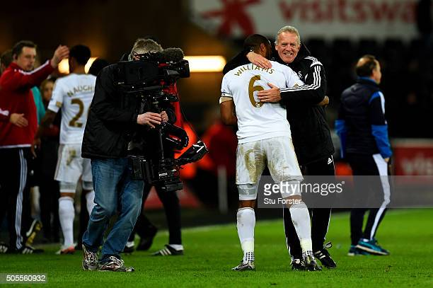 Swansea City interim manager Alan Curtis congratulates Ashley Williams of Swansea City after the Barclays Premier League match between Swansea City...