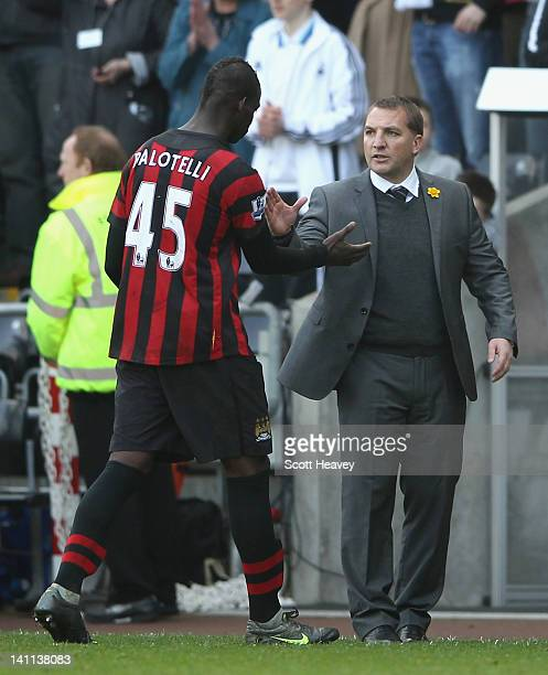 Swansea City manager Brendan Rogers shakes hands with Mario Balotelli of Manchester City after the Barclays Premier League match between Swansea City...