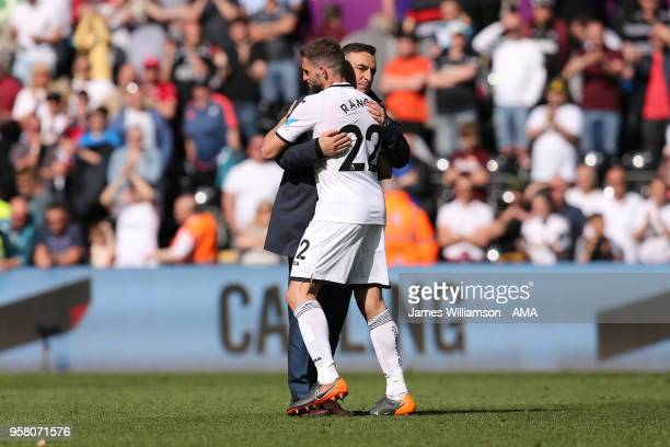 Swansea City manager Carlos Carvalhal and Angel Rangel of Swansea City dejected at full time after relegation is confirmed from the premier league...