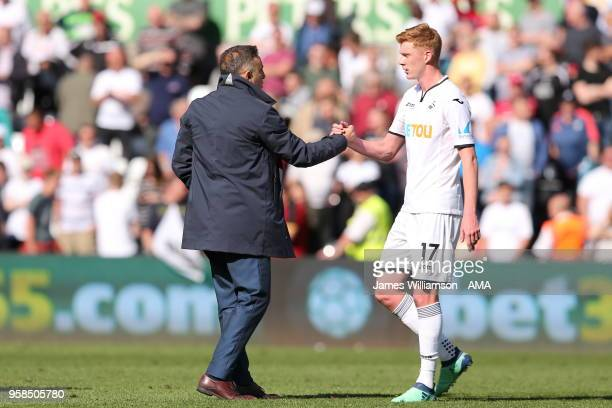 Swansea City manager Carlos Carvalhal and Sam Clucas of Swansea City during the Premier League match between Swansea City and Stoke City at Liberty...