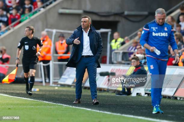 Swansea City manager Carlos Carvalhal gives in instructions during the Premier League match between Swansea City and Stoke City at Liberty Stadium on...