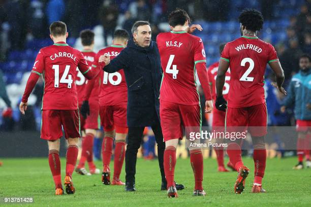 Swansea City manager Carlos Carvalhal shakes hands with Tom Carroll after the final whistle of the Premier League match between Leicester City and...