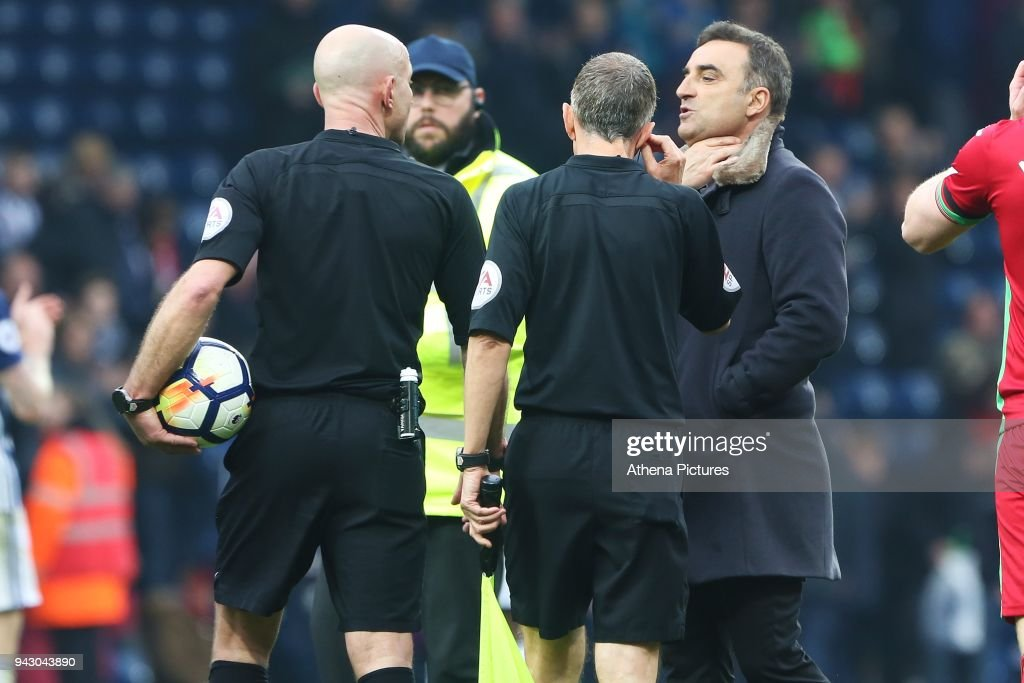 Swansea City manager Carlos Carvalhal talks with Referee Roger East after the final whistle of the Premier League match between Swansea City and West Bromwich Albion at the Hawthorns Stadium on April 07, 2018 in West Bromwich Albion, England.