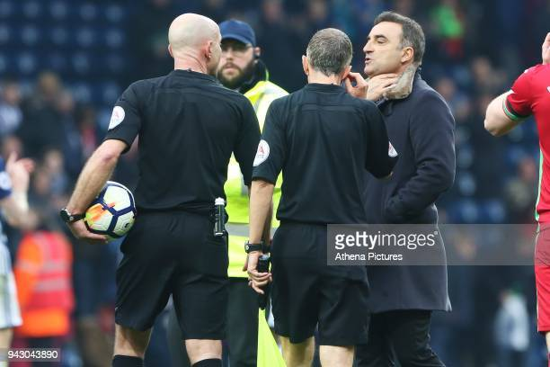 Swansea City manager Carlos Carvalhal talks with Referee Roger East after the final whistle of the Premier League match between Swansea City and West...
