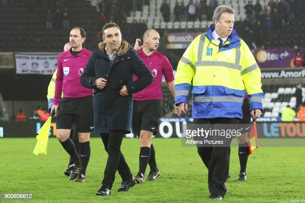 Swansea City manager Carlos Carvalhal walks off the pitch after talking to Referee Bobby Madley after the final whistle of the Premier League match...
