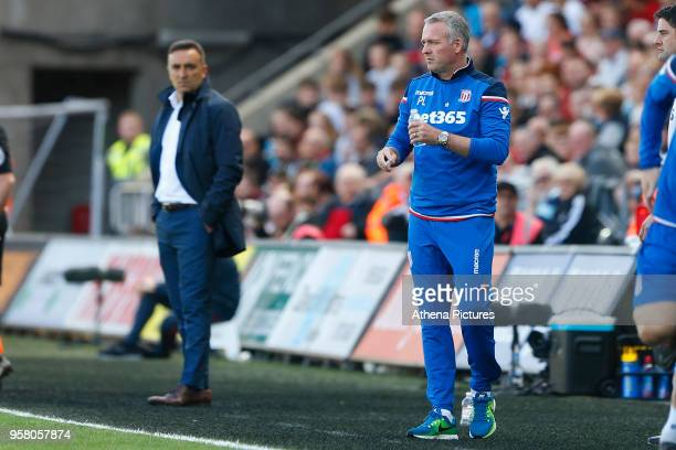 Swansea City manager Carlos Carvalhal watches Stoke City manager Paul Lambert during the Premier League match between Swansea City and Stoke City at...