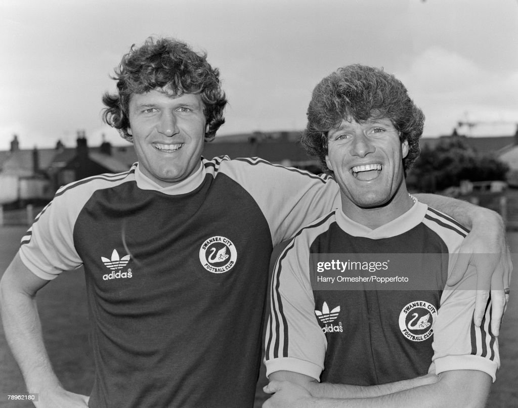 1980-81 Season. Swansea City Photo-call. Former Liverpool pair John Toshack - Manager of Swansea - and Phil Boersma pose for the camera. : News Photo