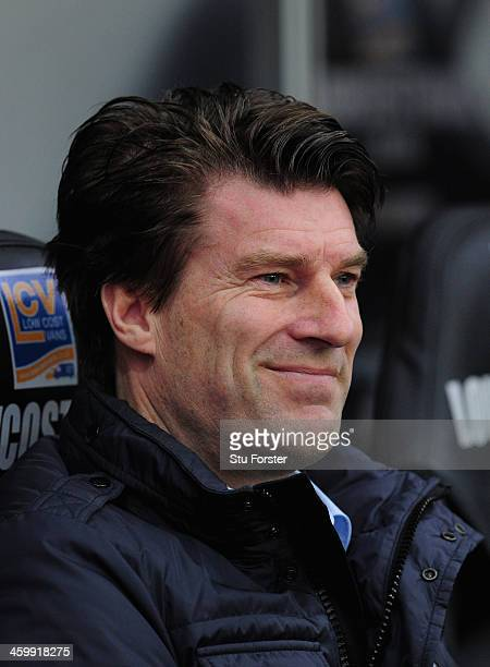 Swansea City manager Michael Laudrup looks on before the Barclays Premier League match between Swansea City and Manchester City at Liberty Stadium on...
