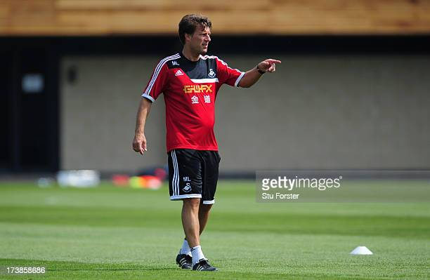 Swansea City manager Michael Laudrup looks on during training at Landore training complex on July 18 2013 in Swansea Wales