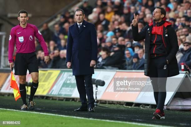 Swansea City manager Paul Clement and Bournemouth assistant Jason Tindall during the Premier League match between Swansea City and Bournemouth at the...