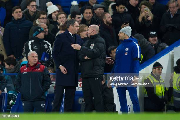 Swansea City manager Paul Clement has words with fourth official Lee Mason during the Premier League match between Chelsea and Swansea City at...