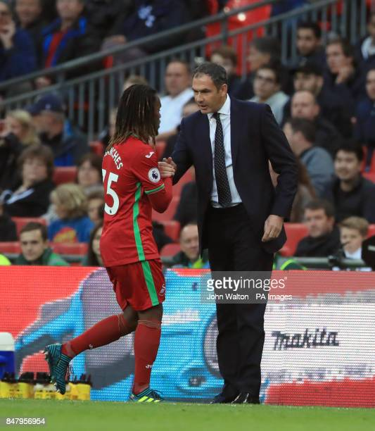 Swansea City manager Paul Clement shakes hands with Renato Sanches as he is substituted during the Premier League match at Wembley Stadium London