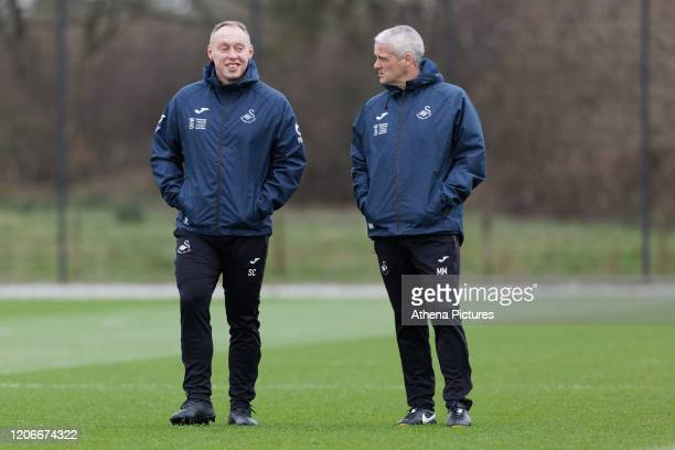 Swansea City manager Steve Cooper and Assistant First Team Coach Mike Marsh watch the players train during the Swansea City Training Session at The...
