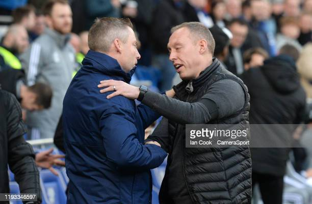 Swansea City manager Steve Cooper shakes hands with Cardiff City manager Neil Harris during the Sky Bet Championship match between Cardiff City and...