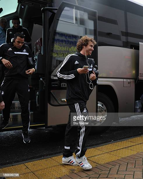 Swansea City player Jose Canas arrives off the bus before the Barclays Premier League match between Cardiff City and Swansea at Cardiff City Stadium...