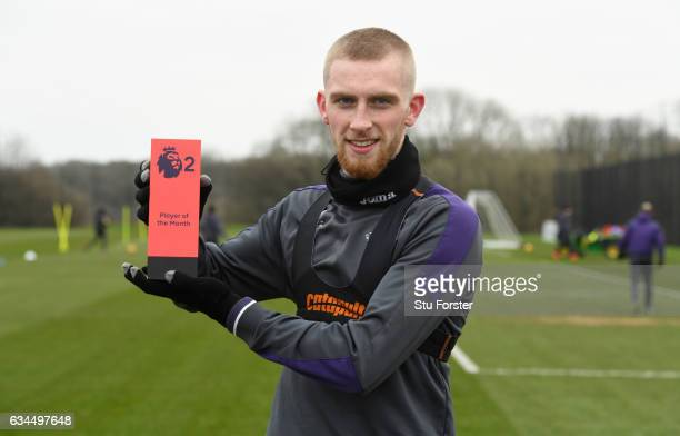 Swansea City player Oliver McBurnie with his Premier League 2 award with team mates at Swansea City's training ground at Fairwood on February 9 2017...