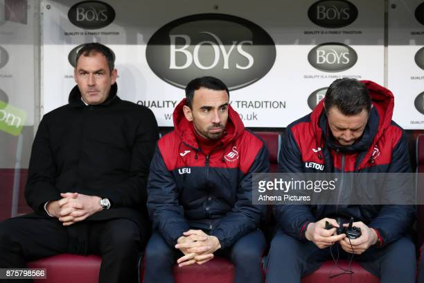 Swansea City PlayerAssistant manager Leon Britton sits on the bench prior to the Premier League match between Burnley and Swansea City at Turf Moor...