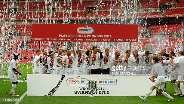 Swansea City players celebrate following their team's 4-2 victory over Reading during the 2011 Championship play-off final football match at Wembley...